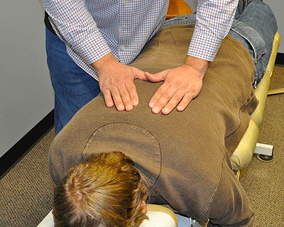 Dr. Ungerank performs a thoracic spine adjustment.